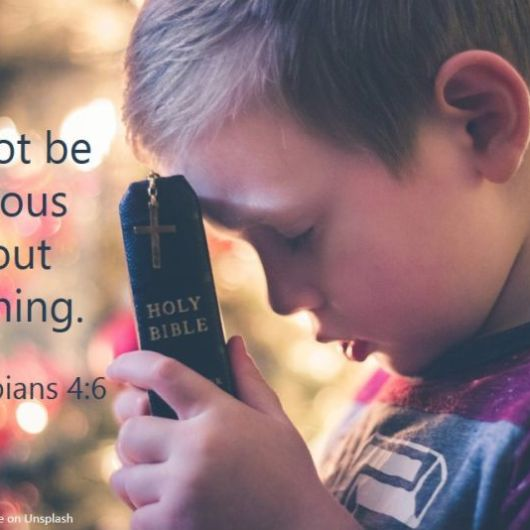 Boy with Bible and text: Do Not Be Anxious About Anything.