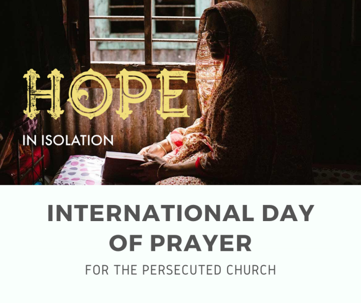 Woman reading a Bible alone by an open window, to encourage prayer for Christians isolated due to persecution.