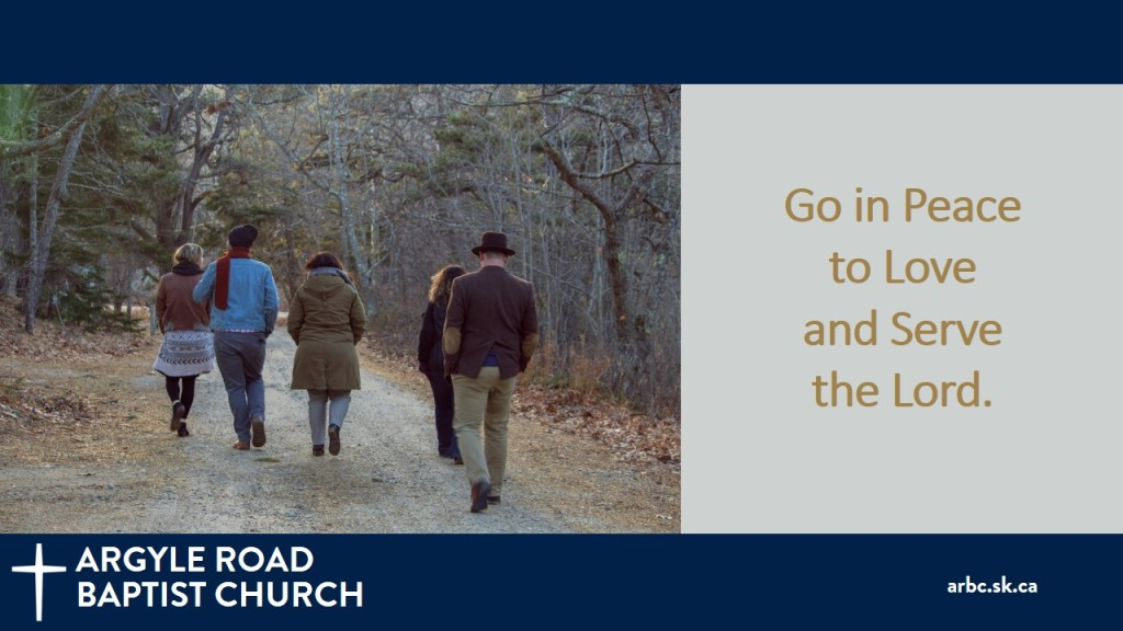 """People walking down a path with dry leaves. Text is """"Go in Peace to Love and Serve the Lord."""""""