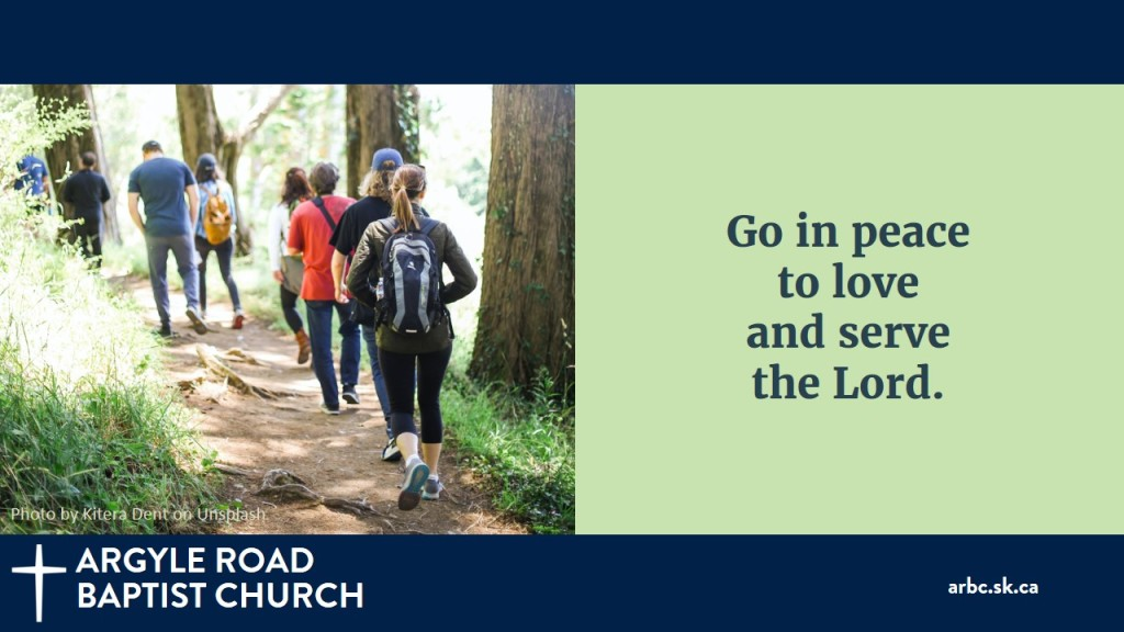 """People walking on a forest path to illustrate """"Go in peace to love and serve the Lord."""""""